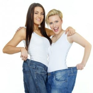 Beautiful girls are proud to lose weight, show Their jeans © Karin & Uwe Annas - Fotolia.com